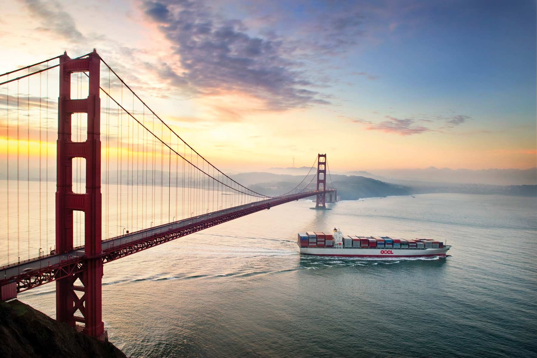 Contact The Gombos Company - OOCL vessel sails under the Golden Gate Bridge